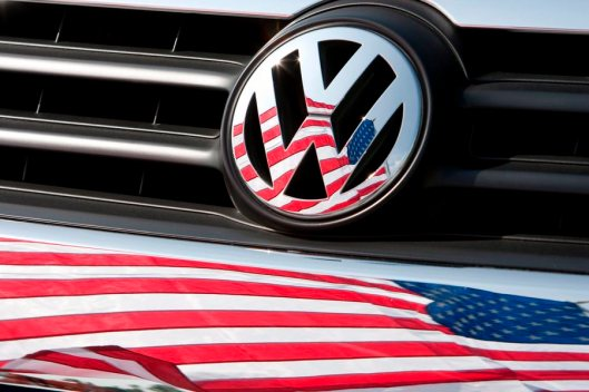 epa04942152 (FILE) A file photo dated 13 May 2009 of a US flag being reflected in the logo and front of a Volkswagen car in Chattanooga, Tennessee, USA. Volkswagen's shares plunged on 21 September 2015 after US environmental protection authorities threatened to impose fines of up to 18 billion dollars on the carmaker, following its admission of systematically cheating US air pollution tests. EPA/FRISO GENTSCH